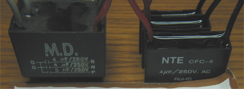 New capacitors next to older three-capacitors-in-one module
